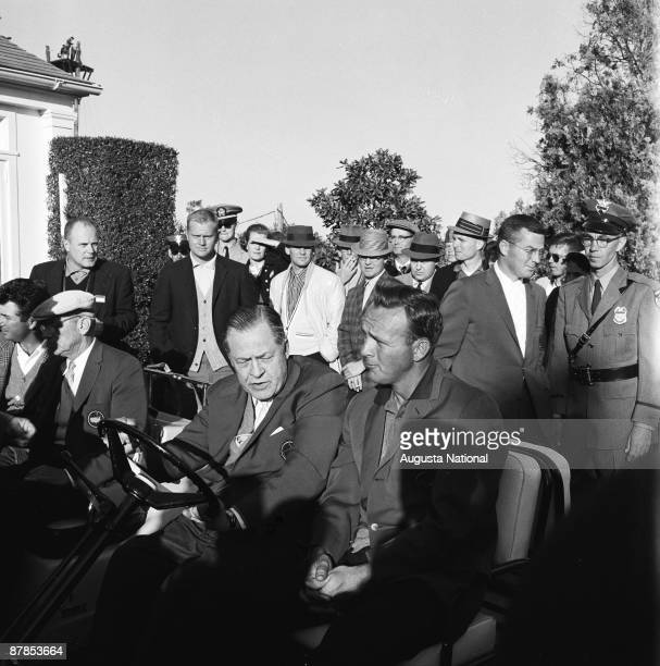 Winner Arnold Palmer rides alongside Bobby Jones as Jack Nicklaus looks on after the 1960 Masters Tournament at Augusta National Golf Club in April...