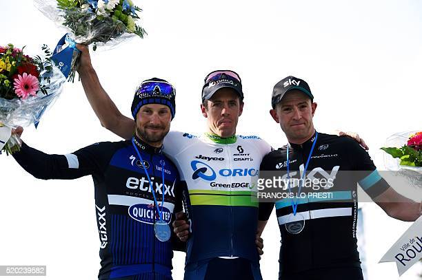 Winner Australia's Mathew Hayman secondplaced Belgium's Tom Boonen and thirdplaced Great Britain's Ian Stannard celebrate on the podium at the end of...