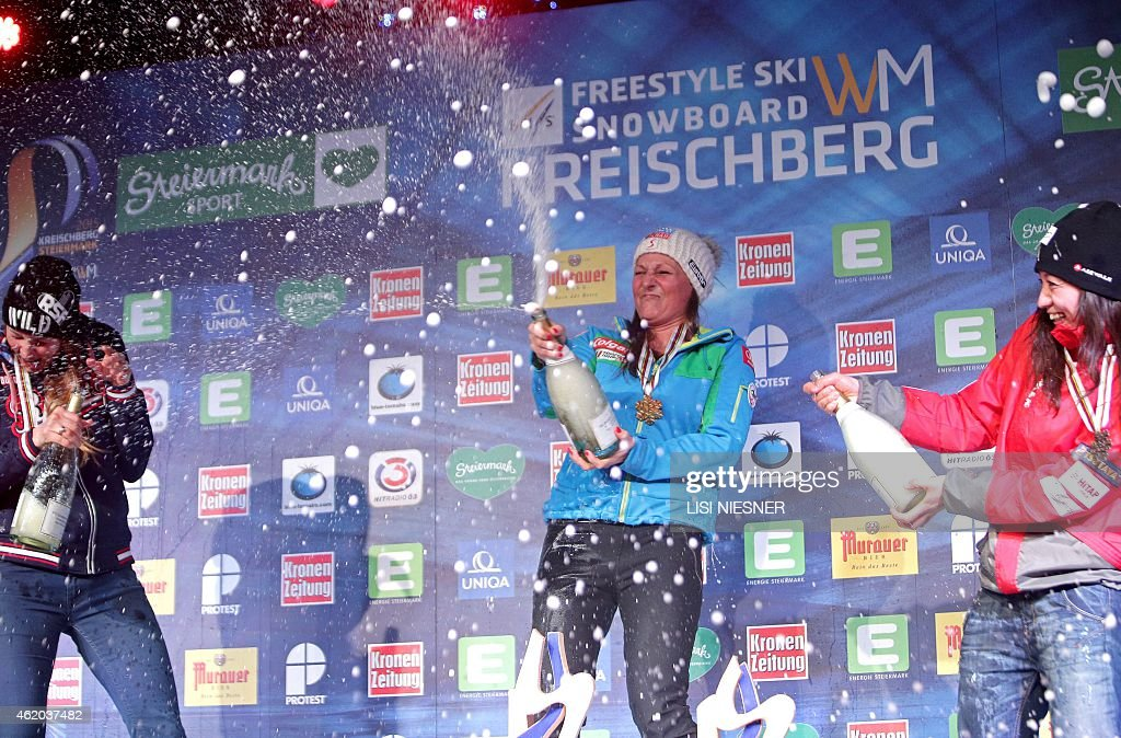 Winner Austria's <a gi-track='captionPersonalityLinkClicked' href=/galleries/search?phrase=Claudia+Riegler+-+Austrian+Snowboarder+-+Born+1973&family=editorial&specificpeople=12458153 ng-click='$event.stopPropagation()'>Claudia Riegler</a> (C), second-placed Russia's <a gi-track='captionPersonalityLinkClicked' href=/galleries/search?phrase=Alena+Zavarzina&family=editorial&specificpeople=6598104 ng-click='$event.stopPropagation()'>Alena Zavarzina</a> (L) and third placed Japan's <a gi-track='captionPersonalityLinkClicked' href=/galleries/search?phrase=Tomoka+Takeuchi&family=editorial&specificpeople=6719453 ng-click='$event.stopPropagation()'>Tomoka Takeuchi</a> (R) celebrate on the podium after for the Women's Snowboard Parallel Giant Slalom Finals at the FIS Freestyle and Snowboarding World Ski Championships 2015 in Kreischberg, Austria on January 23, 2015.
