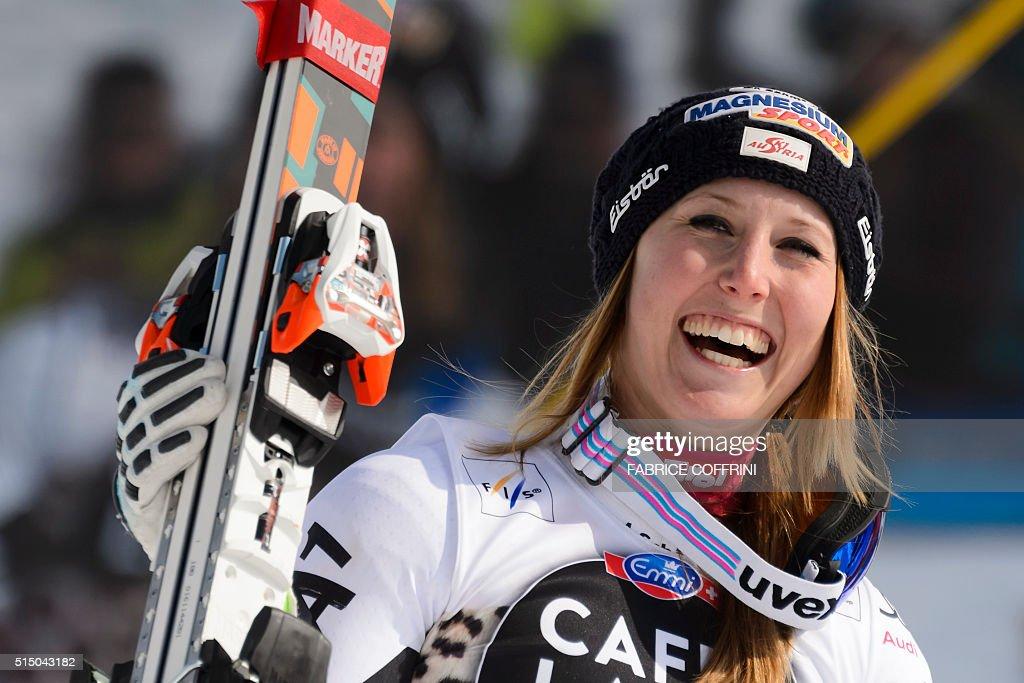 Winner Austria's Cornelia Huetter celebrates after wining FIS Alpine Skiing World Cup Women's SuperG race on March 12 2016 in Lenzerheide Austria's...
