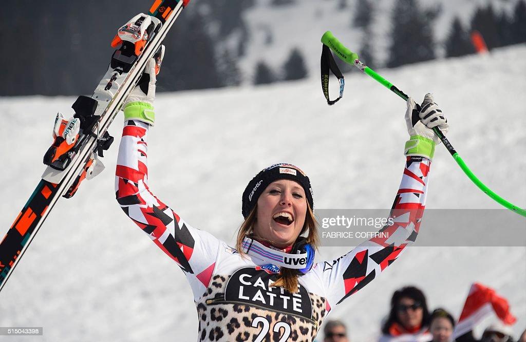 Winner Austria's Cornelia Huetter celebrates after winning the FIS Alpine Skiing World Cup Women's SuperG race on March 12 2016 in Lenzerheide...