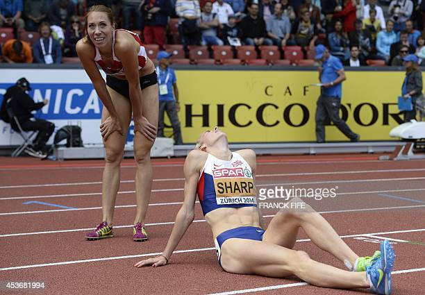Winner Belarus' Maryna Arzamasova and secondplaced Great Britain's Lynsey Sharp catch their breath after competing in the Women's 800m final during...