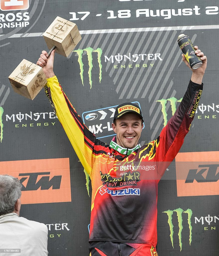 Winner Belgian Clement Desalle celebrates on the podium after the motocross MX1 Belgian Grand Prix, on August 18, 2013 in Bastogne.