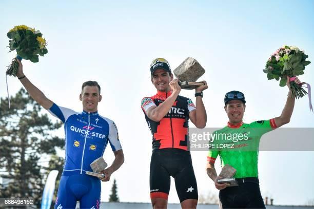 Winner Belgium's Greg Van Avermaet secondplaced Czech Republic's Zdenek Stybar and thirdplaced Netherlands' Sebastian Langeveld celebrate on the...
