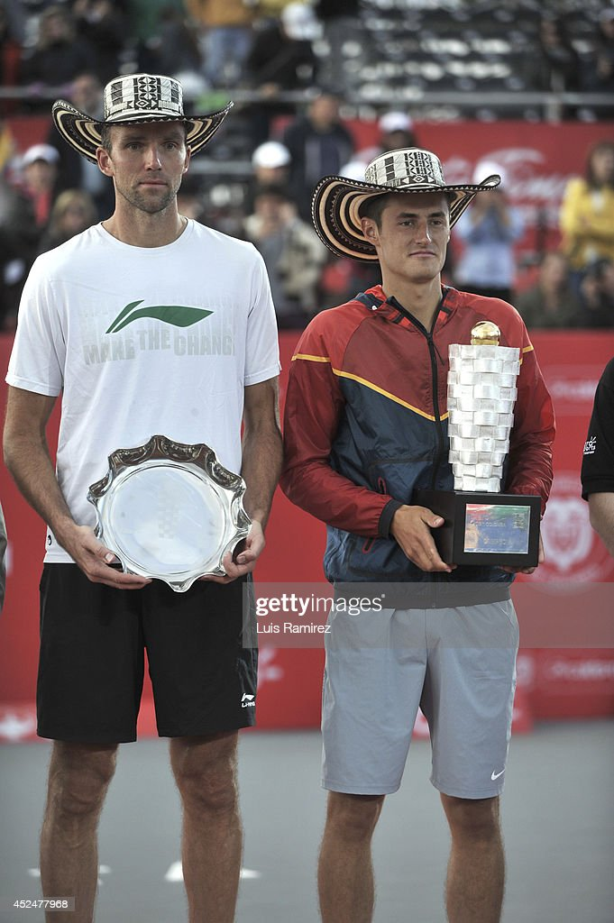 Winner <a gi-track='captionPersonalityLinkClicked' href=/galleries/search?phrase=Bernard+Tomic&family=editorial&specificpeople=650713 ng-click='$event.stopPropagation()'>Bernard Tomic</a> of Australia (R), and second place <a gi-track='captionPersonalityLinkClicked' href=/galleries/search?phrase=Ivo+Karlovic&family=editorial&specificpeople=605320 ng-click='$event.stopPropagation()'>Ivo Karlovic</a> of Croatia pose for a photo during a tennis match between <a gi-track='captionPersonalityLinkClicked' href=/galleries/search?phrase=Bernard+Tomic&family=editorial&specificpeople=650713 ng-click='$event.stopPropagation()'>Bernard Tomic</a> of Australia and <a gi-track='captionPersonalityLinkClicked' href=/galleries/search?phrase=Ivo+Karlovic&family=editorial&specificpeople=605320 ng-click='$event.stopPropagation()'>Ivo Karlovic</a> of Croatia as part of ATP Claro Open Colombia Final on July 20, 2014 in Bogota, Colombia.