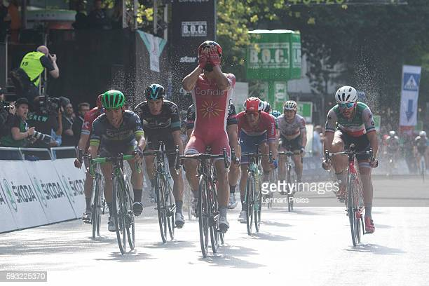Winner Caleb Ewan from Australia and set back Nacer Bouhanni from France react at the finish line during the Euroeyes Cyclassics Hamburg on August 21...