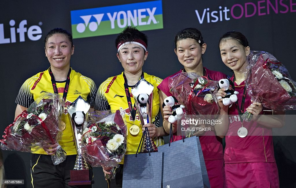 Winner China's Wang Xiaoli and Yu Yang second placed Japan's Ayaka Takahashi and Misaki Matsutomo pose with their trophies after the women double...