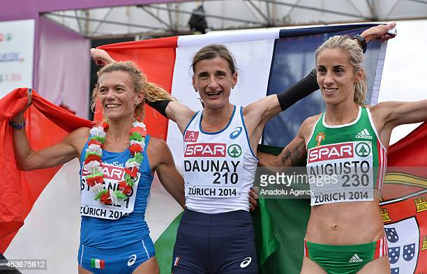 Winner Christelle Daunay of France second place winner Valeria Straneo of Italy and third place winner Jessica Augusto of Portugal pose with their...