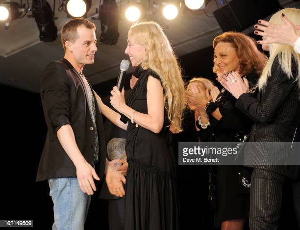 Winner Christian Wijnants accepts his award from judges Franca Sozzani Diane Von Furstenberg and Donatella Versace at the 2013 International Woolmark...