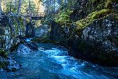 The glacier fed waters of Winner Creek cut though a rocky gorge in Girdwood, Alaska