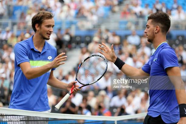 Winner Daniil Medvedev of Russia shakes hands with runner up Thanasi Kokkinakis of Australia following their mens singles second round match on day...