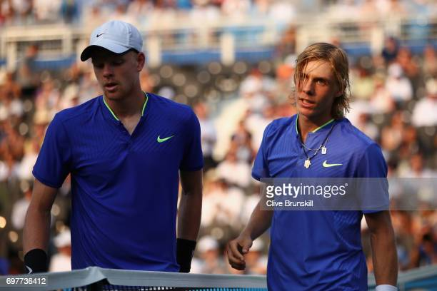 Winner Denis Shapovalov of Canada shakes hands with runner up Kyle Edmund of Great Britain following their mens singles first round match during day...