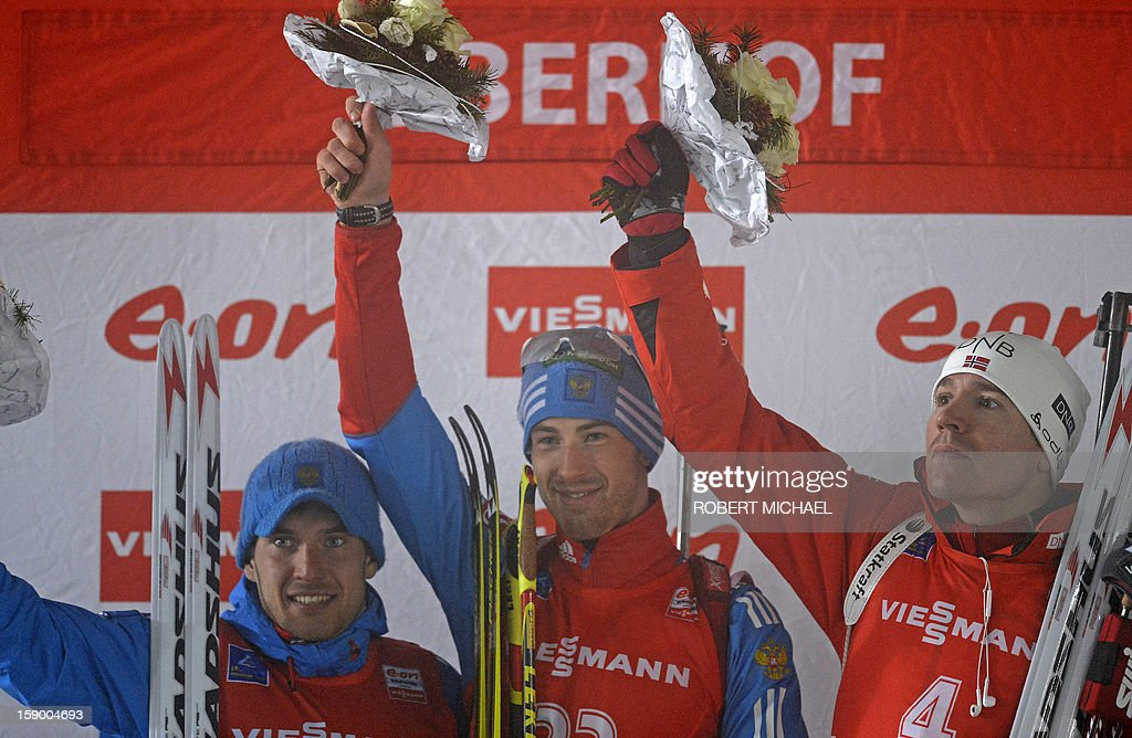 Winner Dmitry Malyshko of Russia (C), second placed Evgeniy Garnichev of Russia (L) and third placed Emil Hegle Svendsen of Norway celebrate on the podium after the men's 10 km sprint event of the IBU biathlon World Cup in Oberhof, eastern Germany, on January 5, 2013.