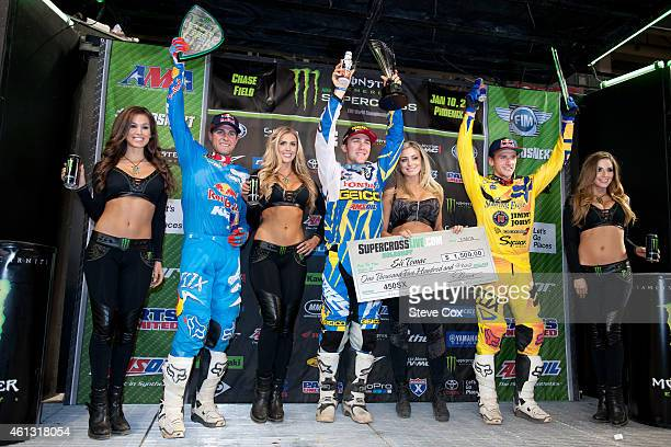 Winner Eli Tomac thirdplace Ryan Dungey and secondplace Ken Roczen celebrate on the 450cc podium at the Monster Energy/AMA Supercross at Chase Field...