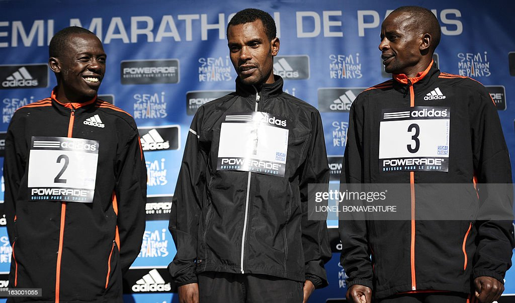 Winner Ethiopian athlete Abebe Negewo (C), second placed Kenya's Daniel Sale (L) and third placed Stephen Kiprotich (R) pose on the podium after winning the 21st edition of the Paris Half-Marathon on March 3, 2013 in Paris.
