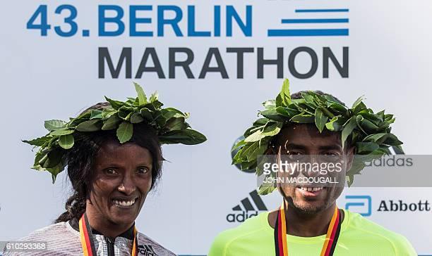 Winner Ethiopian Kenenisa Bekele and winner Ethiopian Aberu Kebede pose on the podium after winning the 43rd Berlin Marathon in Berlin on September...