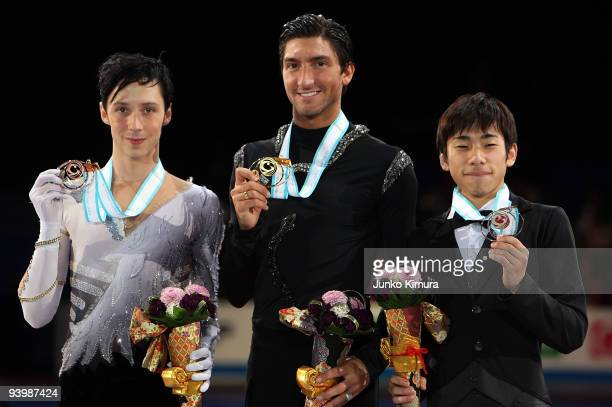 Winner Evan Lysacek of the USA 2nd placed Nobunari Oda of Japan and Johnny Weir of the USA pose with their medals after competing in the Men Free...