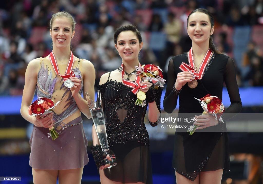 Полина Цурская - Страница 13 Winner-evgenia-medvedeva-of-russia-poses-with-secondplace-carolina-picture-id872780572