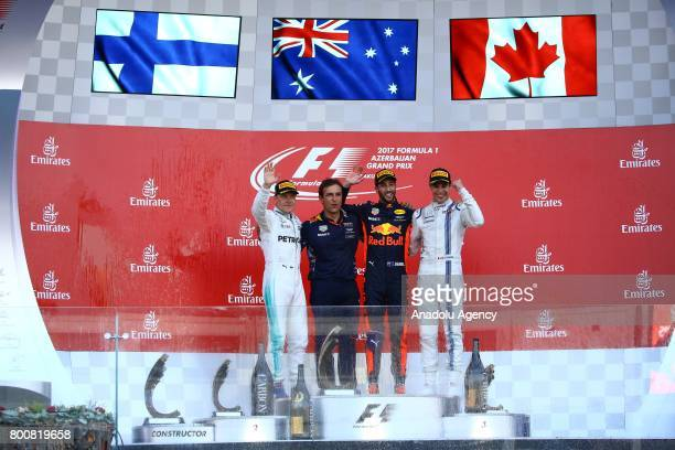 Winner F1 Pilot Daniel Ricciardo of Australia and Red Bull Racing 2nd placed Mercedes Pilot Valterri Bottas and 3rd placed Williams Martini Racing's...