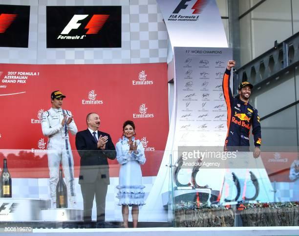 Winner F1 Pilot Daniel Ricciardo of Australia and Red Bull Racing celebrates his victory as Azerbaijani President Ilham Aliyev and his wife Mehriban...