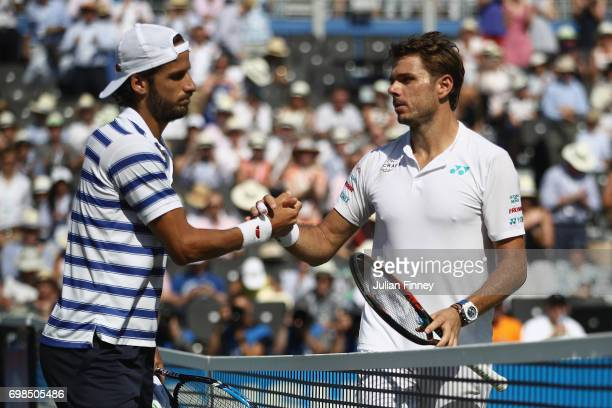 Winner Feliciano Lopez of Spain and runner up Stan Wawrinka of Switzerland shake hands following their mens singles first round match on day two of...