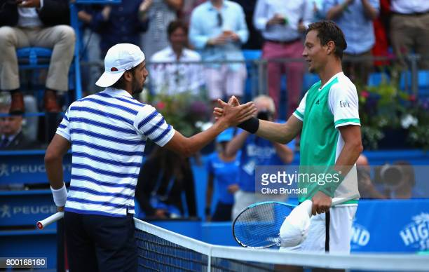 Winner Feliciano Lopez of Spain shakes hands with his opponant Thomas Berdych of The Czech Republic following their mens singles quarter final match...