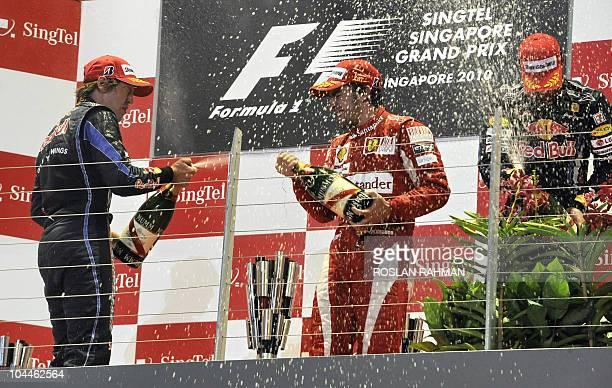 Winner Ferrari driver Fernando Alonso of Spain thirdplaced Red BullRenault driver Mark Webber of Australia and secondplaced Red BullRenault driver...