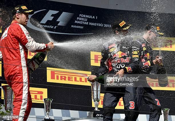 Winner Ferrari's German driver Sebastian Vettel third placed Infiniti Red Bull Racing's Australian driver Daniel Ricciardo and Second placed Infiniti...