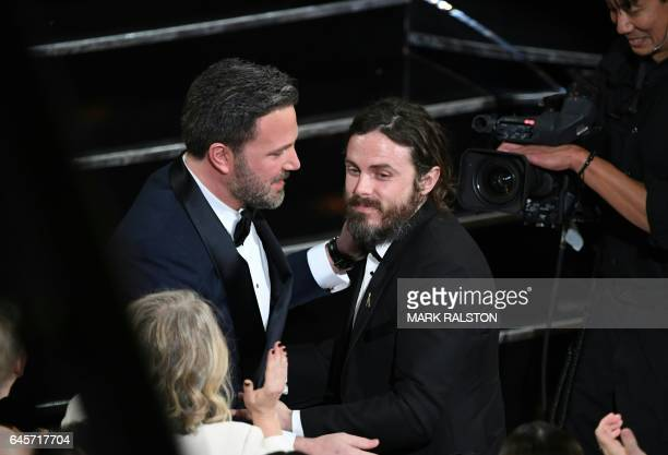 TOPSHOT Winner for Best Actor 'Manchester By The Sea' Casey Affleck is embraced by his brother Ben Affleck on stage at the 89th Oscars on February 26...