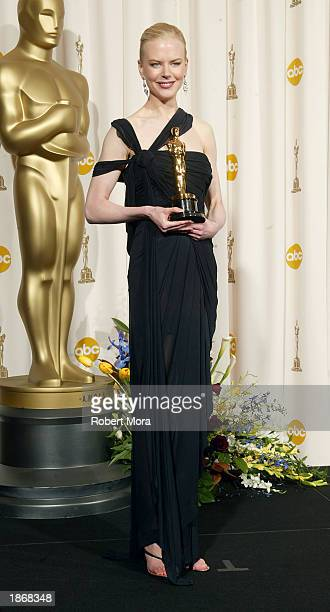 Winner for Best Actress for 'The Hours' Nicole Kidman poses backstage during the 75th Annual Academy Awards at the Kodak Theater on March 23 2003 in...