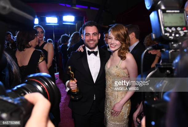 Winner for Best Actress 'La La Land' Emma Stone poses with her brother Spencer at the 89h Annual Academy Awards Governors Ball in Hollywood...