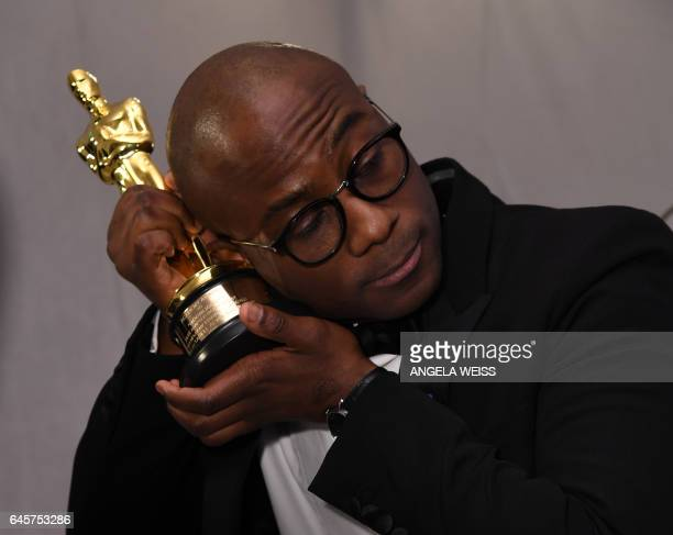 TOPSHOT Winner for Best Director 'Moonlight' Barry Jenkins holds his trophy at the 89h Annual Academy Awards Governors Ball in Hollywood California...