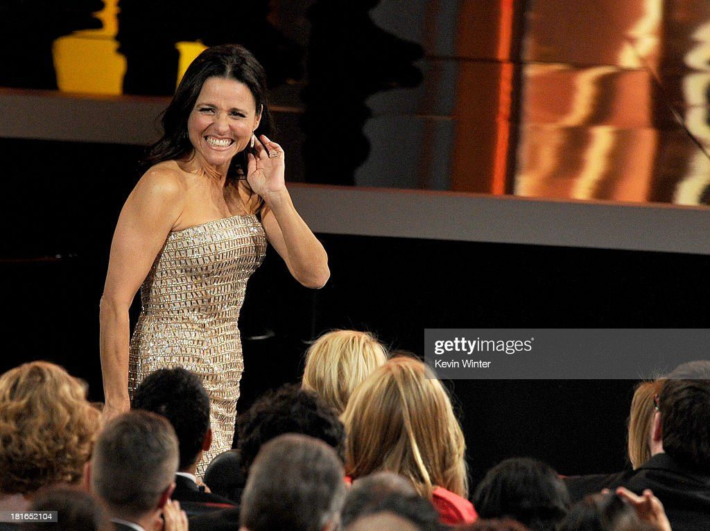 Winner for Best Lead Actress in a Comedy Series, <a gi-track='captionPersonalityLinkClicked' href=/galleries/search?phrase=Julia+Louis-Dreyfus&family=editorial&specificpeople=208965 ng-click='$event.stopPropagation()'>Julia Louis-Dreyfus</a> walks onstage during the 65th Annual Primetime Emmy Awards held at Nokia Theatre L.A. Live on September 22, 2013 in Los Angeles, California.