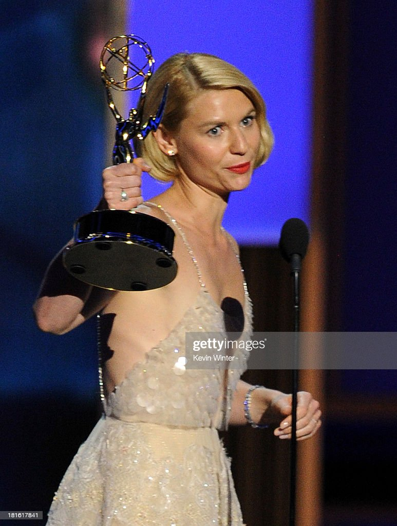 Winner for Best Lead Actress in a Drama Series, <a gi-track='captionPersonalityLinkClicked' href=/galleries/search?phrase=Claire+Danes&family=editorial&specificpeople=202666 ng-click='$event.stopPropagation()'>Claire Danes</a> accepts her award onstage during the 65th Annual Primetime Emmy Awards held at Nokia Theatre L.A. Live on September 22, 2013 in Los Angeles, California.