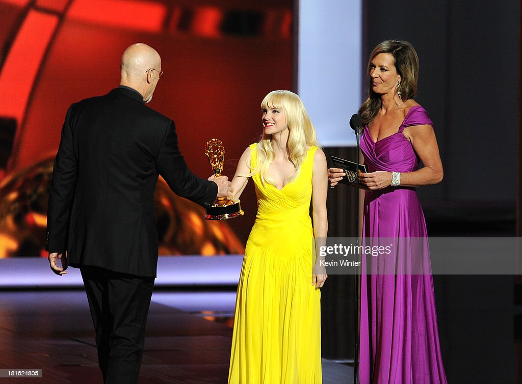 Winner for Best Supporting Actor in a Miniseries or Movie, James Cromwell accepts his award from actresses Anna Faris and Allison Janney onstage during the 65th Annual Primetime Emmy Awards held at Nokia Theatre L.A. Live on September 22, 2013 in Los Angeles, California.