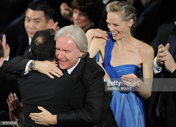 Winner for Cinematography Mauro Fiore for 'Avatar' receives a hug from director James Cameron at the 82nd Academy Awards at the Kodak Theater in...