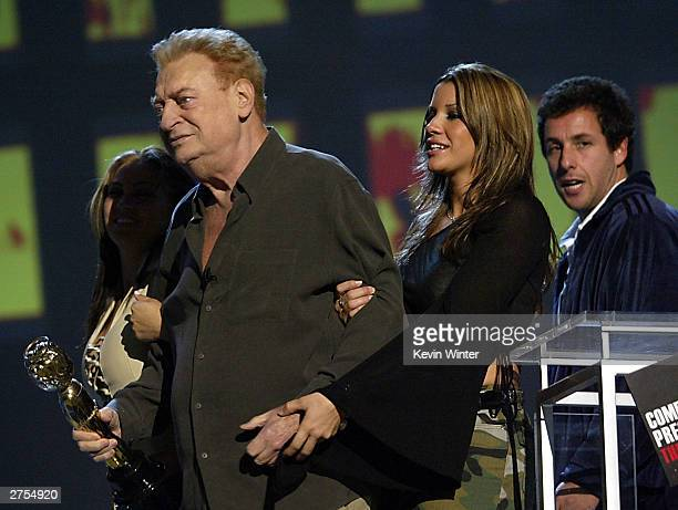 Winner for 'Comedy Idol' Award winner Rodney Dangerfield with The Juggies and comedian Adam Sandler leaves the stage during Comedy Central's First...