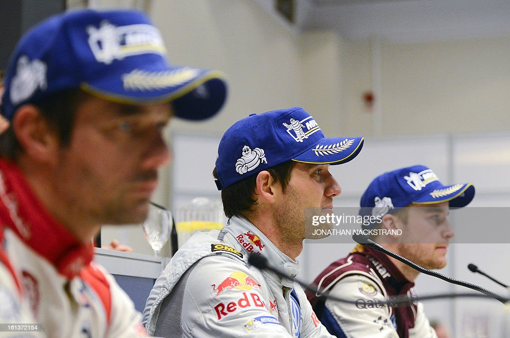 Winner France's Sebastien Ogier (C), 2nd placed France's Sebastien Loeb (L) and Norway's Mads Ostberg react during a press conference of Rally Sweden, second round of the FIA World Rally Championship on February 10, 2013 in Karlstad, Sweden.