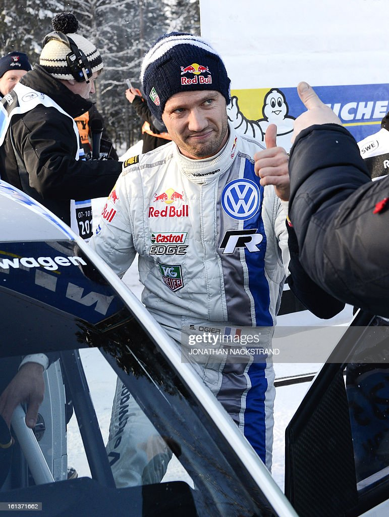 Winner France's Sebastien Ogier reacts after crossing the finish line of the 22nd and the last stage of Rally Sweden, FIA World Rally Championship second round in Karlstad, Sweden on February 10, 2013. AFP PHOTO/JONATHAN NACKSTRAND