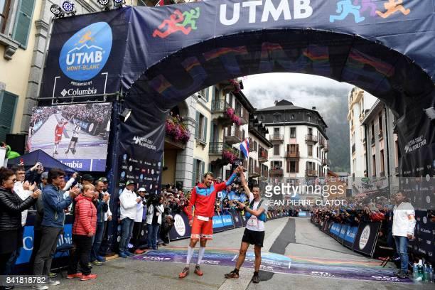 Winner French athlete Francois D'Haene and secondplaced Spanish athlete and former Mount Blanc Ultra Trail winner Kilian Jornet celebrate after...