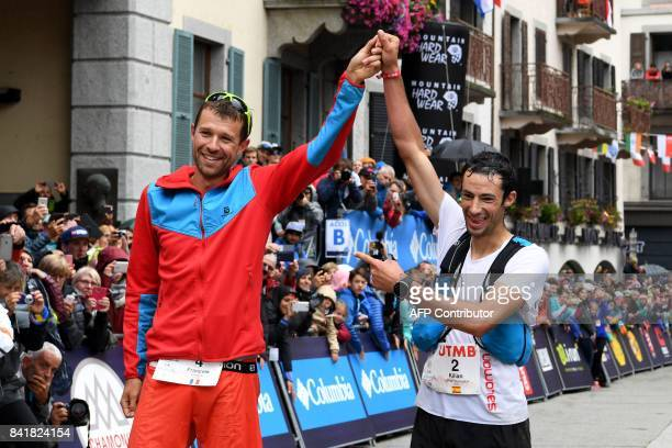 Winner French athlete Francois D'Haene and secondplaced Spanish athlete Kilian Jornet celebrate after crossing the finish line of the 15th edition of...