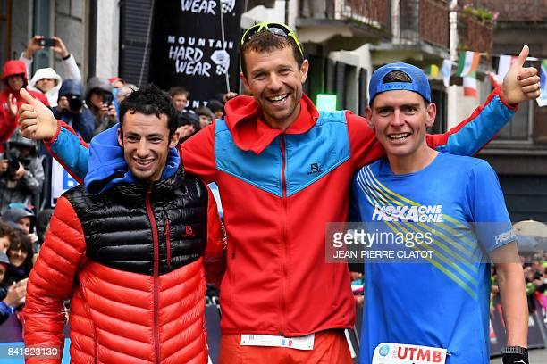 Winner French athlete Francois D'Haene secondplaced Spanish athlete Kilian Jornet and thirdplaced US athlete Tim Tollefson celebrate after crossing...