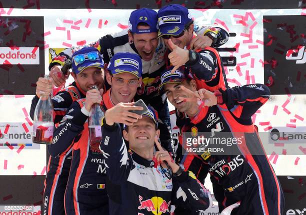 Winner French driver Sebastien Ogier takes a selfie photo with his French codriver Julien Ingrassia and Belgian codriver Nicolas Gilsoul Belgian...