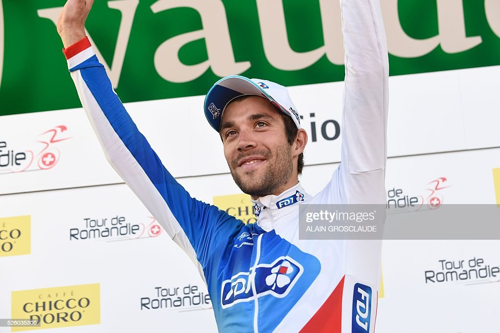 Winner French's Thibault Pinot of FDJ celebrates on the podium of the fourth stage of the 70th Tour de Romandie UCI World Tour, a 15 km individual time-trial in Sion, on April 29, 2016, in Lausanne. / AFP / Alain Grosclaude