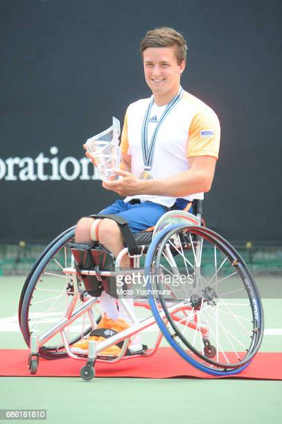 Winner Gordon Reid of Great Britain celebrates with the trophy at the medal ceremony for the Men's Singles during day six of the Wheelchair Tennis...