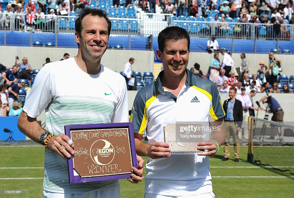 Winner <a gi-track='captionPersonalityLinkClicked' href=/galleries/search?phrase=Greg+Rusedski&family=editorial&specificpeople=201807 ng-click='$event.stopPropagation()'>Greg Rusedski</a> and runner up <a gi-track='captionPersonalityLinkClicked' href=/galleries/search?phrase=Tim+Henman&family=editorial&specificpeople=167277 ng-click='$event.stopPropagation()'>Tim Henman</a> of Great Britain pose with their Cadbury World plaques after their mixed doubles exhibition match with respective partners Sorana Cirstea of Romania and Heather Watson of Great Britain during day one of the AEGON Classic tennis tournament at Edgbaston Priory Club on June 9, 2013 in Birmingham, England.