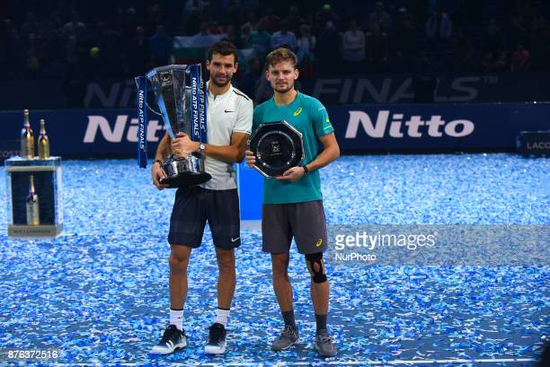 Winner Grigor Dimitrov of Bulgaria and runner up David Goffin of Belgium hold their trophies following the singles final during day eight of the 2017...