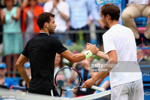 Winner Grigor Dimitrov of Bulgaria shakes hands with his opponant Daniil Medvedev of Russia after their mens singles quarter final match on day five...