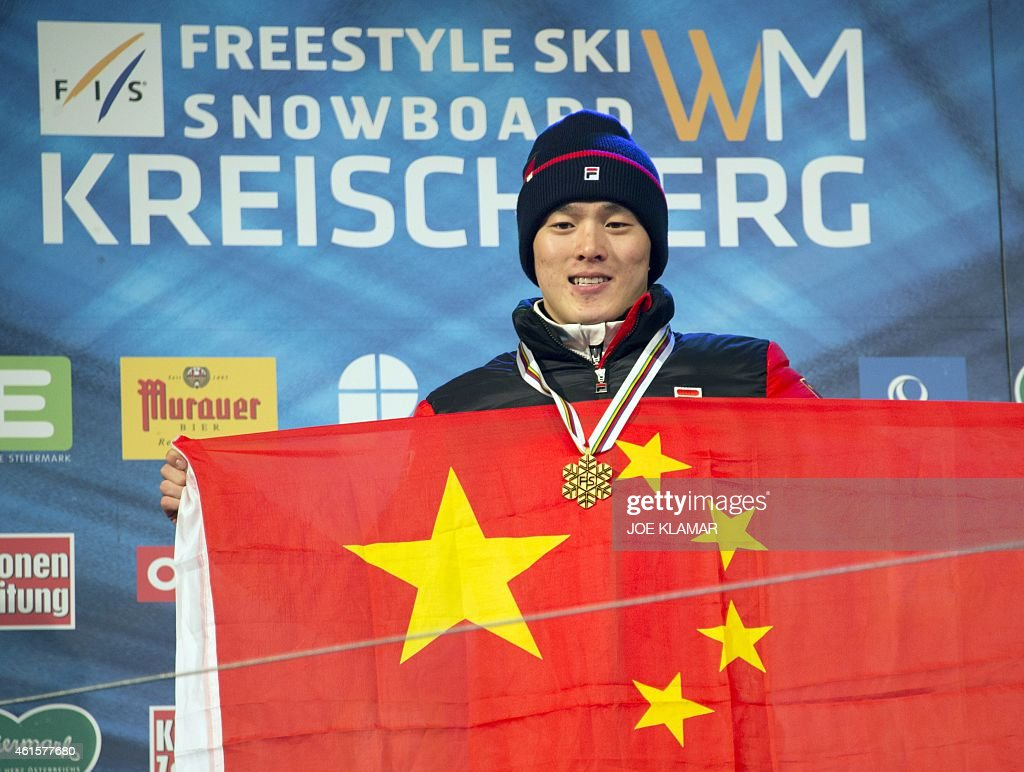 Winner Guangpu Qi of China celebrates at the podium of the Men's Aerials Finals during FIS Freestyle and Snowboarding World Ski Championships 2015 in Kreischberg, Austria on January 15, 2015.