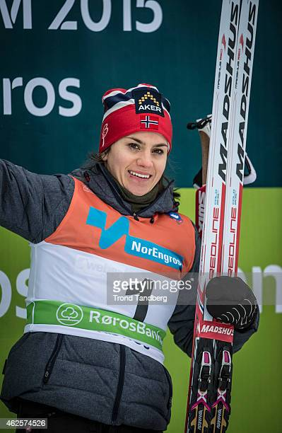 Winner Heidi Weng celebrates on the podium after the Lady 15 km Skiatlon during the Norwegian Championship Cross Country on January 31 2015 in Roros...